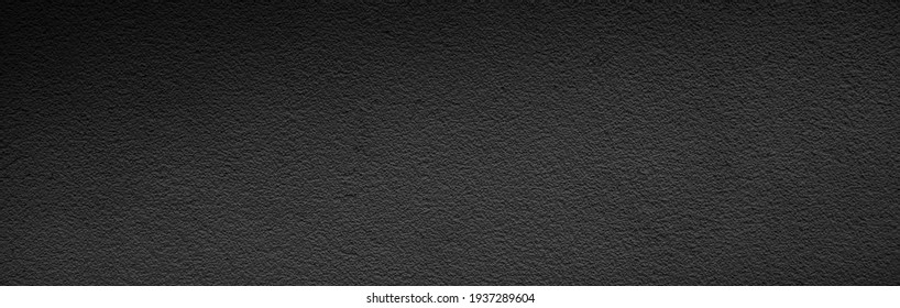 Banner of black asphalt texture. Wide black textured background. Shiny glossy dark panoramic surface
