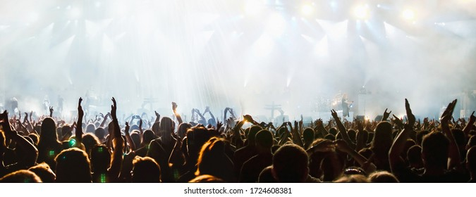 banner of cheering crowd and stage lights with space for your text - Shutterstock ID 1724608381