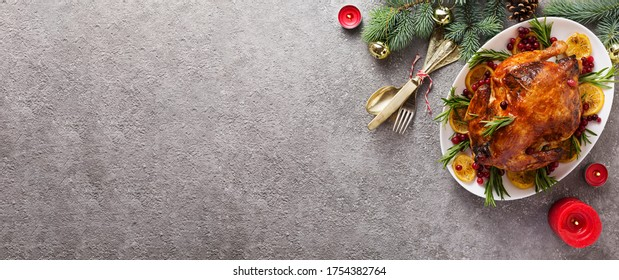 banner Christmas table with baked turkey or chicken, copy space for text. Christmas dinner