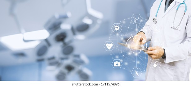 Banner close up of healthcare and medical doctor using smart tablet device for research development on coronavirus and diagnosis on patient health concept, surgeon scrub and stethoscope in hospital