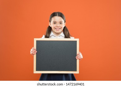banner concept. blackboard for copy space. information. write hometask. back to school. happy teachers day. 1 september. small girl demonstrate announcement. happy small school girl with chalkboard.