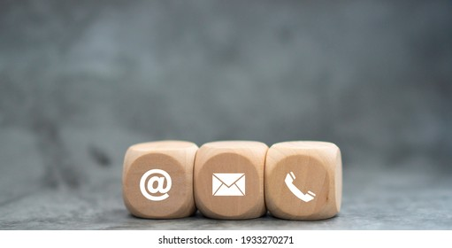 Banner of contact us icon (phone, email, mail ) on wood cube, customer service and support for self quarantine business working at home for Coronavirus or virus preventing concept