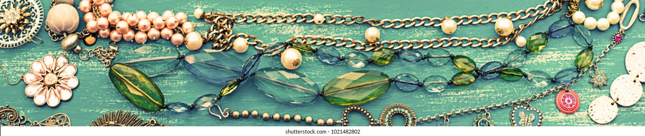 Banner Decorative background for text. Empty picture frame jewelry on a painted wooden background. Top view Flat lay