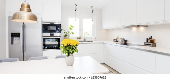 banner of a fancy kitchen with yellow roses on the kitchen table