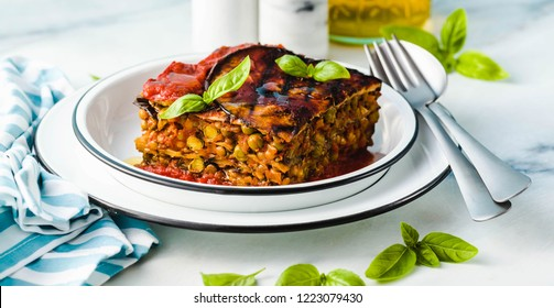 banner of gluten free vegan lasagna. from grilled eggplant, green peas, lentils and vegetables. delicious healthy comfort food for the whole family for the holidays. italian parmigiana