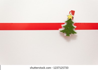 Banner for greeting card. Christmas tree on a white background with a red stripe. Advertising poster. Background for congratulations happy new year and Christmas.
