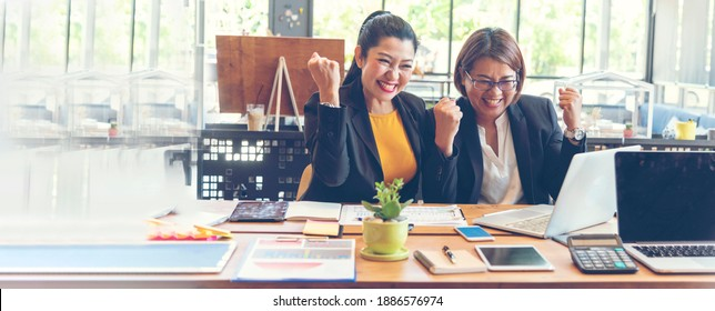 Banner Happy success business woman partner meeting working together in company office. Panoramic picture of Meeting Executive Asian business woman office desk with fist arm raised executive teamwork