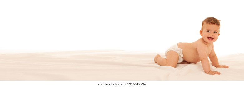 Banner with Hapy baby boy in playing on bed isolated over white