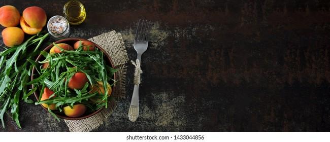 Banner. Healthy arugula salad apricot. Dietary food. Bright healthy salad. Super Food
