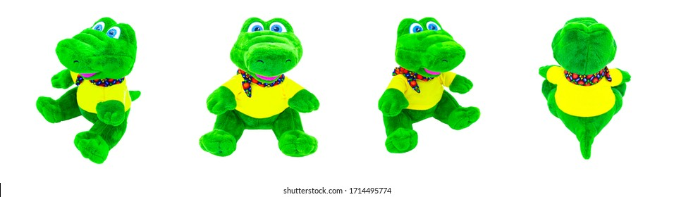 Banner of isolated soft toys of a green crocodile on different sides on a white background.