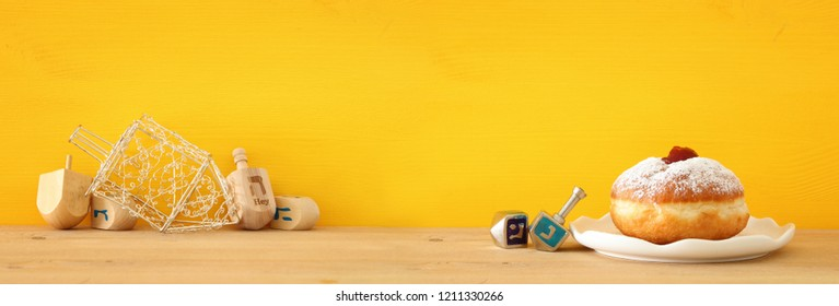 Banner of jewish holiday Hanukkah with wooden dreidels (spinning top)