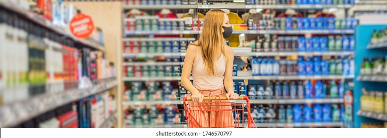 BANNER, LONG FORMAT larmed female wears medical mask against coronavirus while purchase of household chemicals in supermarket or store- health, safety and pandemic concept - young woman wearing