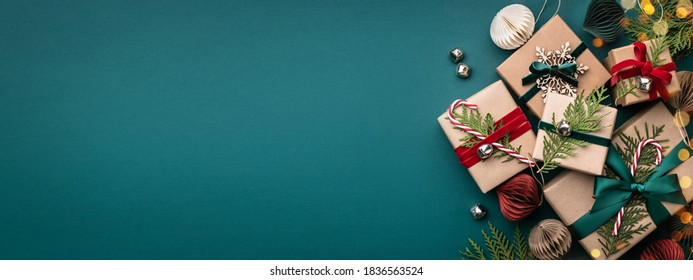 Banner with many gift boxes tied velvet ribbons and paper decorations on turquoise background. Christmas background. - Shutterstock ID 1836563524