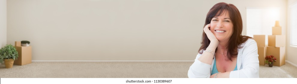 Banner of Middle Aged Woman Relaxing Inside Empty Room With Moving Boxes.
