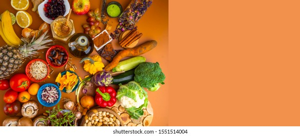 Banner of mixed colorful foods, and pills, contains antioxidants, vitamins, fiber. Immune boosting products. Healthy clean concept. Superfoods