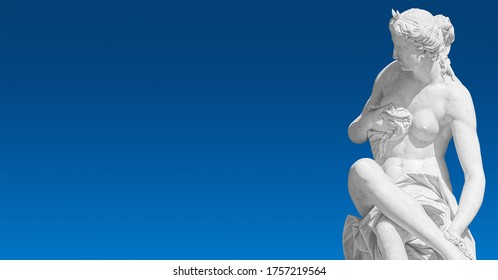 Banner with old statue of sensual bathing Renaissance Era woman at blue smooth gradient sky background with copy space, Potsdam, Germany