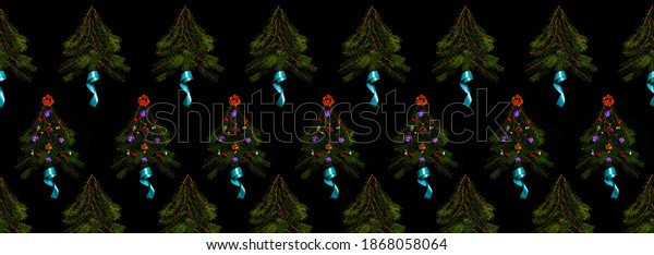 Banner Pattern of Christmas trees on a black background, photography. Repeating elements of Christmas trees made of pine branches decorated with flowers. Festive christmas print. Selective focus.