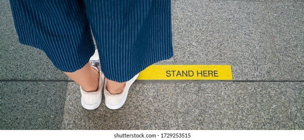 Banner photo of Asian woman standing on social distancing sign for keep distance and queue for entrance subway train a new normal life trend. corona virus, social distancing or new normal concepts - Shutterstock ID 1729253515