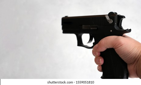Banner a pistol 9mm, in the hands of women, concept as correctly keep a pistol on training. the index finger is not on the trigger, but along the barrel. 9x19 9mm LUGER caliber pistol rounds. Glock