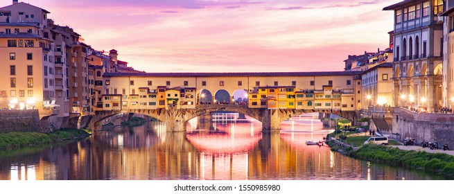 banner of ponte Vecchio on river Arno at night, Florence, Italy