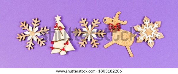Banner Top view Christmas toys and decorations on colorful background. New Year holiday concept with copy space.