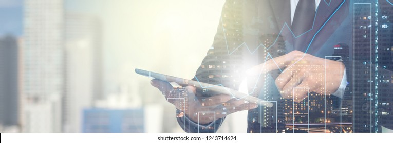 Banner and web page or cover template of Double exposure of businessman using the tablet with Stock market chart on Network connection line between building over the top view of cityscape background