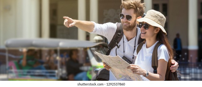 Banner and web page or cover template of Multiethnic Travellers are looking the destination and holding the map at the train station, Travel and transportation concept