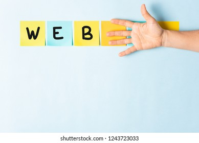 Banner web word concept. Collection of different colored sticky note papers with curled corner, open palm hand hidden three notes and empty three notes.