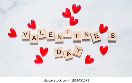 "Banner.The word ""Valentine's Day"". Love on wooden blocks. Theme of love. Wooden letter blocks. Loving, positive emotions. Wooden cubes with the word. An exclusive relationship."