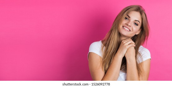 Banner of a young beautiful woman, isolated on pink background