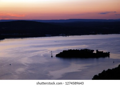 Bannerman Island in the middle of the Hudson River is silhouetted at sunset