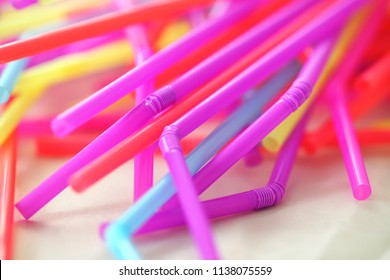 Banning plastic straws enviromental concerns concept, macro close up selective focus.