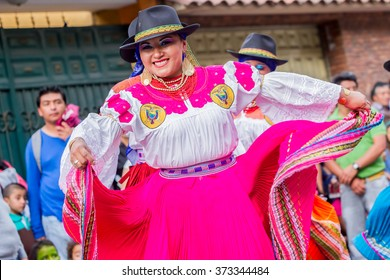 Banos De Agua Santa, Ecuador  - November29, 2014: Group Of Adult Indigenous Women With Traditional Folk Costume Dancing On City Streets, South America