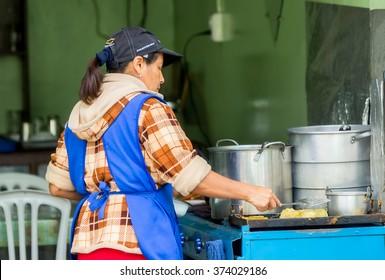 Banos De Agua Santa,  Ecuador- November 29,  2014: Latin Woman Cooking On The Streets Of South America
