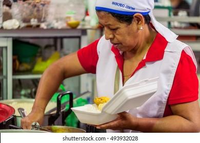 Banos De Agua Santa, Ecuador - 23 2016: Unidentified Chef Woman From Banos De Agua Santa Is Preparing A Dish In Banos De Agua Santa On   23, 2016