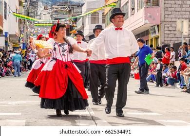 Banos De Agua Santa, Ecuador - 29 November 2014: Multi-Ethnic Couples Dancing On The Streets Of Ecuador, Banos De Agua Santa, South America On November 29, 2014