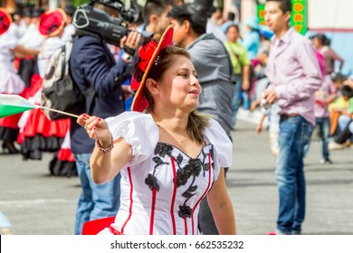 Banos De Agua Santa, Ecuador - 29 November 2014: Hispanic Woman Is Dancing On The Streets Of Banos De Agua Santa, South America, Christmas Holiday On November 29, 2014