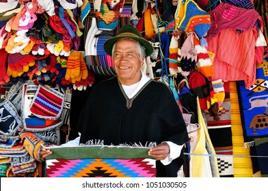 BANOS, ECUADOR - 04 AUGUST 2012: The Equadorian in a traditional national costume is selling handicraft souvenirs in the tourist small town Banos