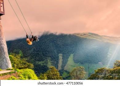 Banos, Ecuador - 30 march 2015: The Swing At The End Of The World Located At Casa Del Arbol, The Tree House In Banos De Aqua Santa, Ecuador, South America
