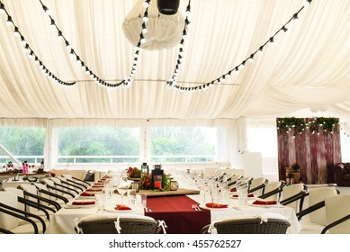 Banquet hall in the marquee and served festive table