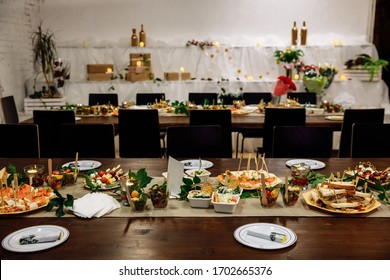 Banquet hall in the restaurant. Concept: Serving. Celebration. Anniversary. Wedding. Numbered table. A variety of salads and snacks