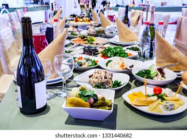 Banquet table prepared for events and celebrations with delicious food and drinks