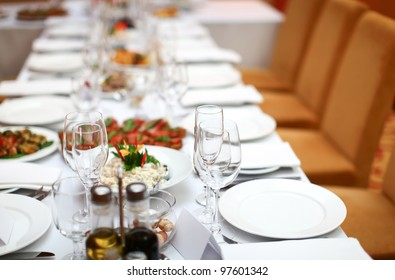 Banquet table in the restaurant prepared for guests.
