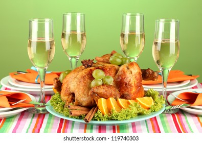 banquet table with roast chicken on green background close-up. Thanksgiving Day
