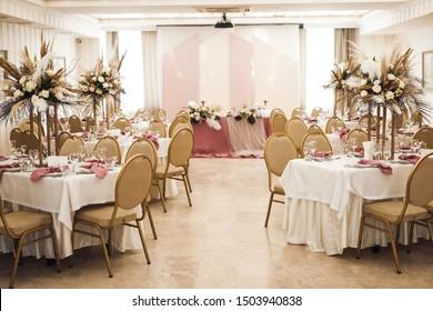 banquets - wedding decor on tables in the restaurant's interior - flower arrangements