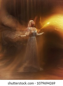 Banshee fairy. Pale girl blonde, like a ghost, in a white vintage dress, flies, hovers in space. Branch of the soul. The girl is a bird, the separation of the soul, the flow of energy. Mary Magdalene.