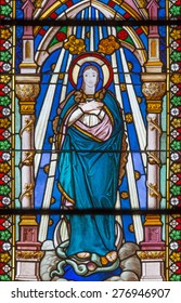 BANSKA BELA, SLOVAKIA - FEBRUARY 5, 2015: The Immaculate Conception on the windowpane of St. John the Evangelist church from end of 19. cent.