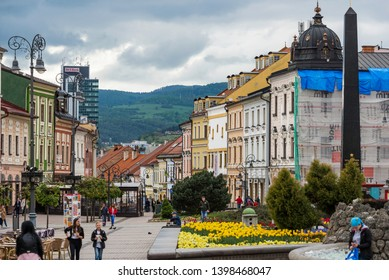 Banska Bystrica, Slovakia - Apr 29, 2019: Young people walking on the pedestrian zone leading to the main square in the town of Banska Bystrica