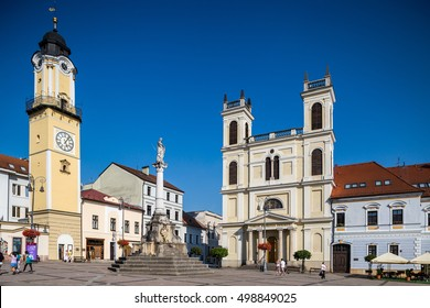 Banska Bystrica, Slovakia - august 07, 2015: Old Main Square, Clock Tower and St. Francis Xavier Cathedral in Banska Bystrica, Slovakia