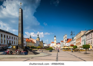 Banska Bystrica, Slovakia - august 07, 2015: Old Main Square with russian soldiers monument, clock tower and towers of all churches in Banska Bystrica, Slovakia